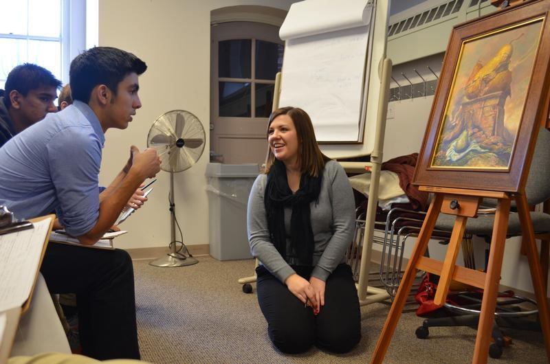 Students from Algonquin High School attend an exhibit of Samuel Bak paintings at the Facing History Brookline offices.