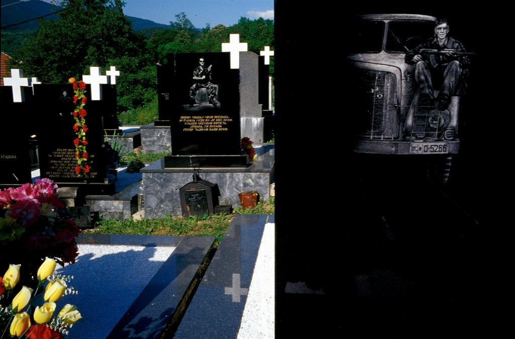 Laser-engraved headstones of Bosnian Serb soldiers who were killed during the war. The cemetery is in Visegrad, in eastern Bosnia, a town where some 2,000 Muslim men and boys were killed by Serbs in the spring of 1992. Eight years after the end of the war, the former Muslim-majority town remains overwhelmingly Serb. Photo courtesy of Sara Terry and the Aftermath Project.
