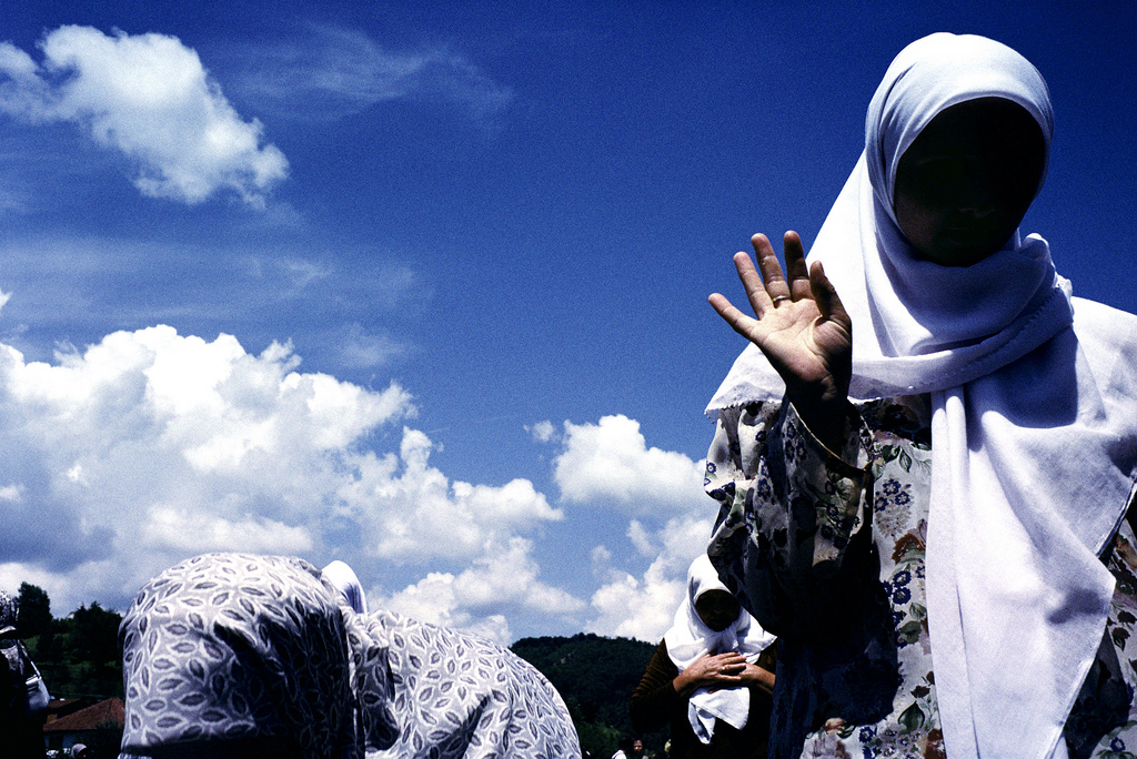 Muslim widows during the prayer for the dead offered at the groundbreaking of a memorial site for the 7,000 to 8,000 Muslim men and boys who were massacred by Bosnian Serb forces in 1995. Photo courtesy of Sara Terry and the Aftermath Project.