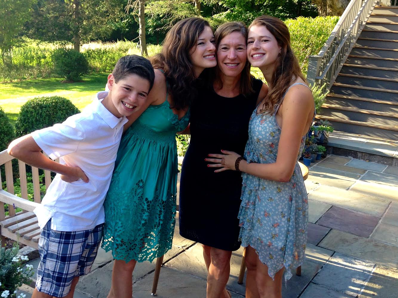 Caren and her three children, from left to right, Simon, Nicole, and Emily.