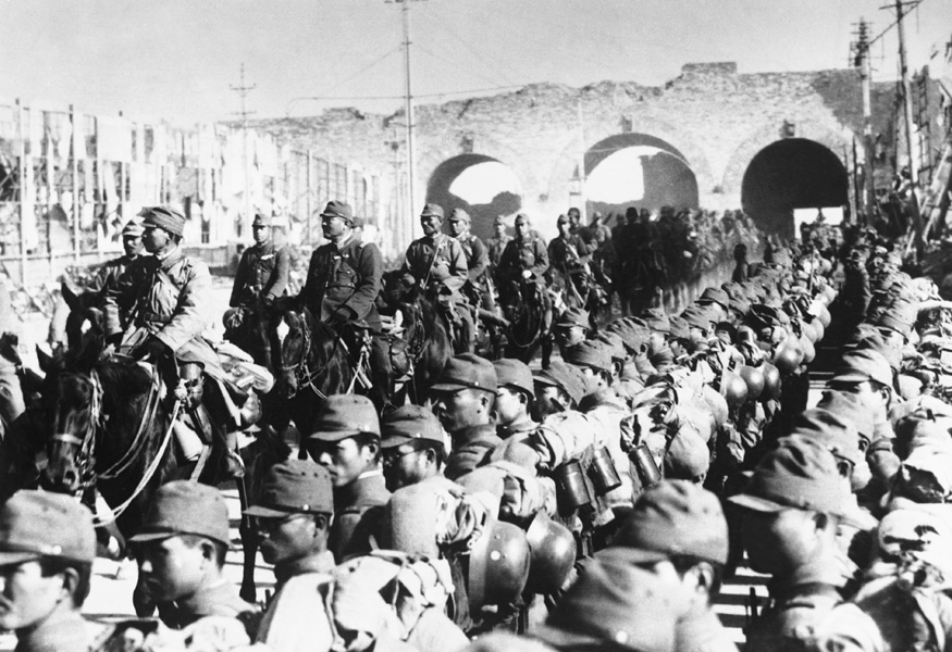 A procession of cavalrymen passes beneath Nanking's arched Chungshan Gate on Jan. 4, 1938, marking the successful capture of the city by Japanese forces. Image by © Hulton-Deutsch Collection/CORBIS