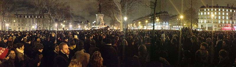 "Mourners gather on the Place de la République following the attacks at the ""Charlie Hebdo"" offices in Paris. Photo from Wikimedia Commons."