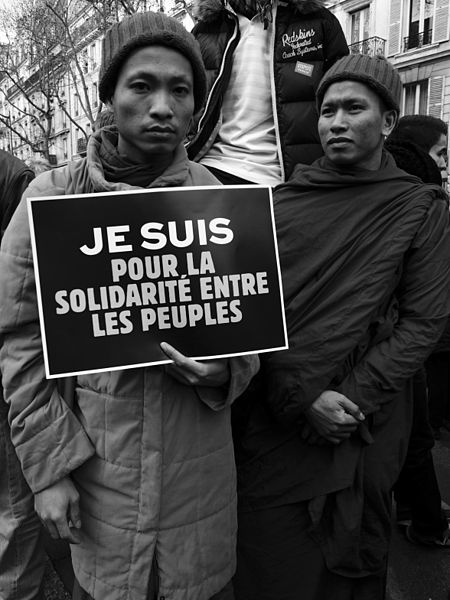 """Parisians come together in support of the victims of the """"Charlie Hebdo"""" shooting on January 11, 2015. Photo courtesy of Passion Leica, Wikimedia Commons."""