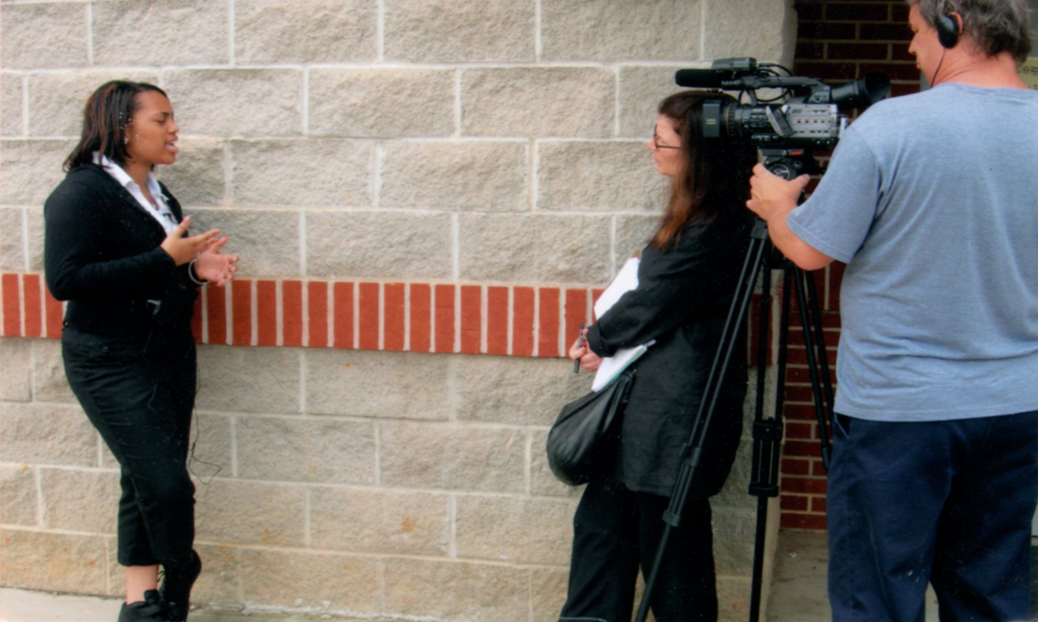 Jaffe on set interviewing a student at Fairfield Preparatory High School in Fairfield, Alabama, about the lasting importance of Harper Lee's classic novel.