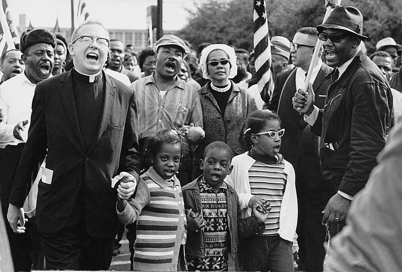 Dr. Ralph David Abernathy and his wife, Mrs. Juanita Abernathy, follow with Dr. and Mrs. Martin Luther King, Jr. as the Abernathy children march on the front line, leading the Selma to Montgomery March in 1965. Photo courtesy of the Abernathy Family.