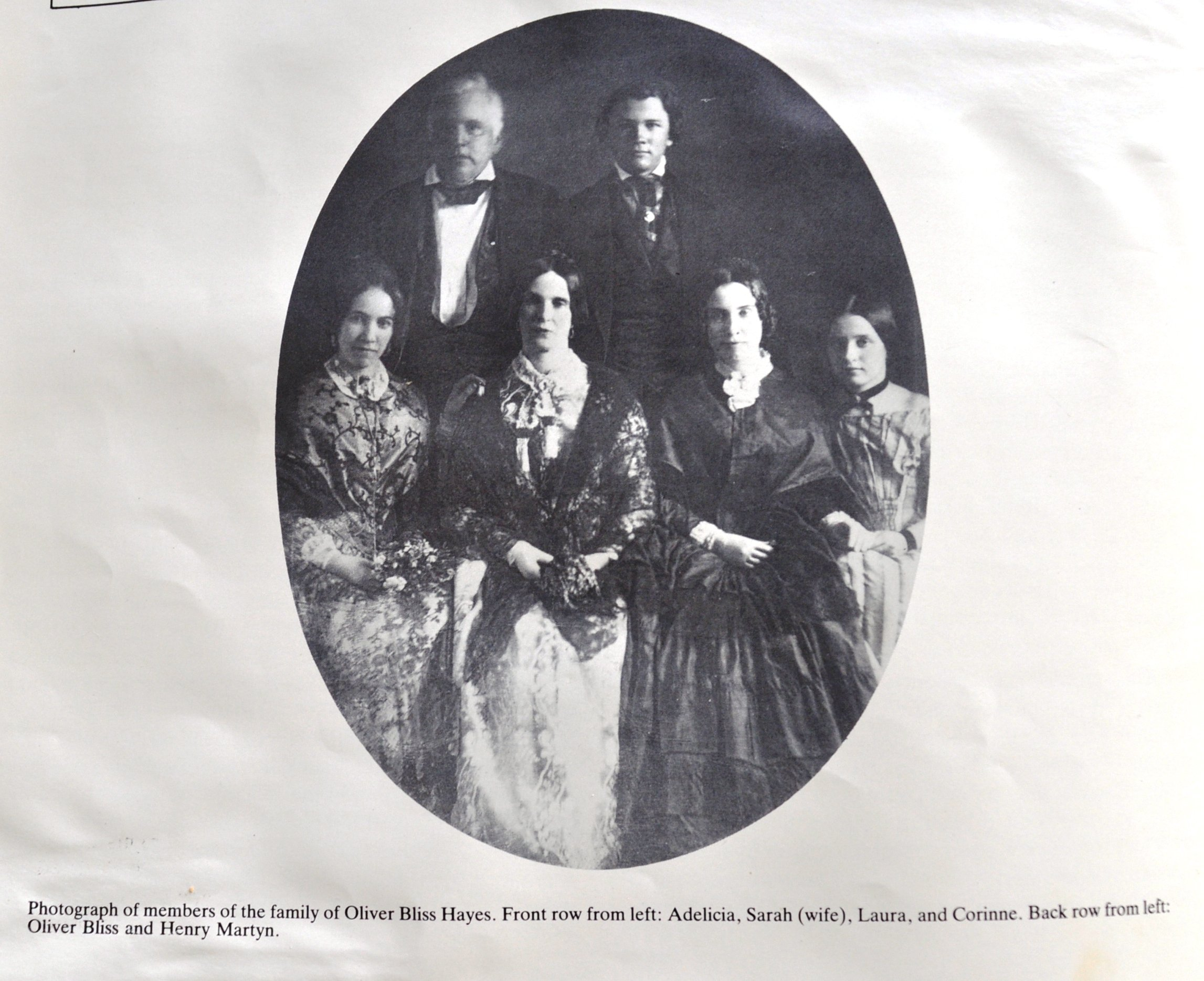 A photo of the author's ancestors. Adelicia is pictured on the far left while Corinne is on the far right.