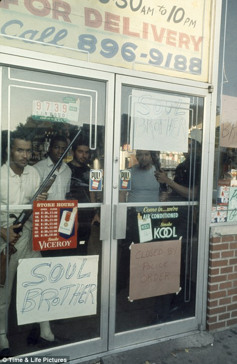 African American store owners protecting their store in the aftermath of the Detroit riots of 1967. Copyright Time and Life Pictures.