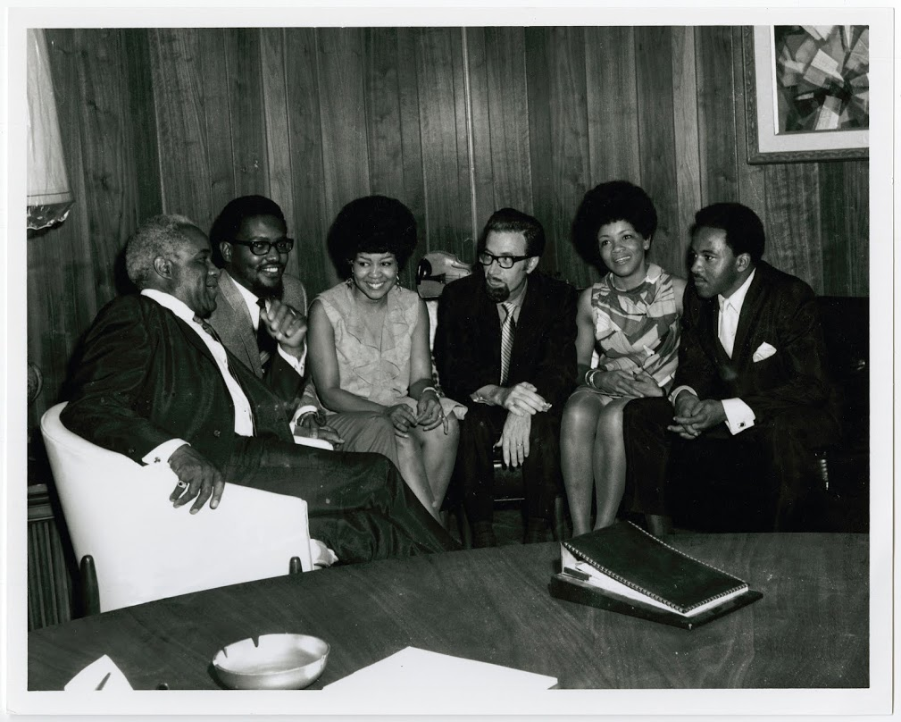 The Staple Singers sit with the owners of Stax Records, Al Bell and Jim Stewart, in Memphis, TN. Photo courtesy of Stax Museum of American Soul Music.