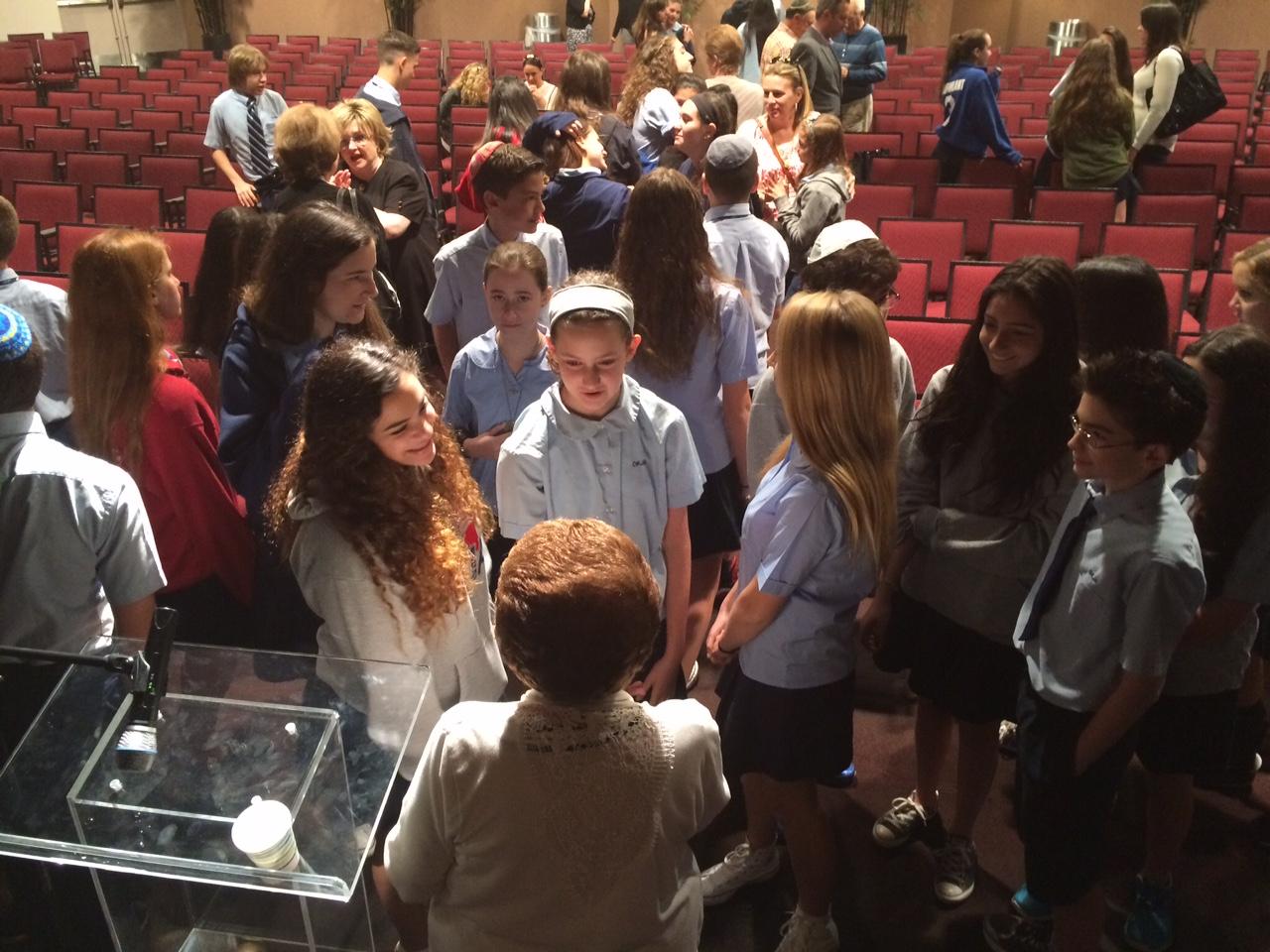 Yaffa Englander and her classmates speak with Holocaust survivor Rena Finder