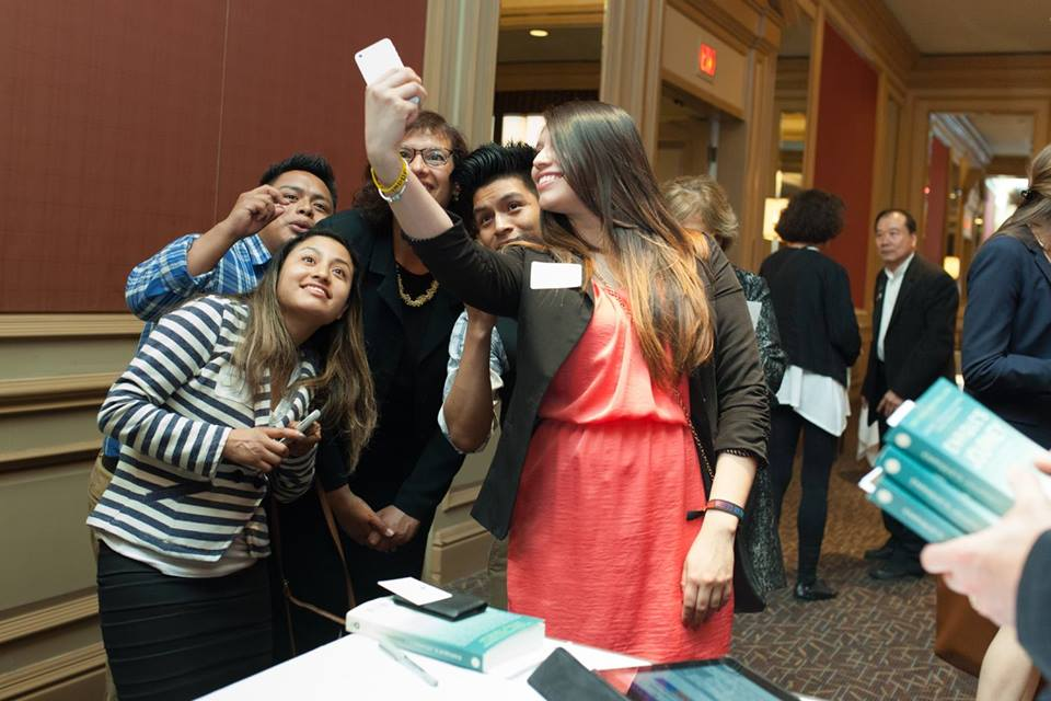 Students taking selfies with Sonia during one of her speaking tours.