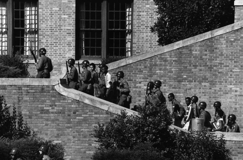 Pictured above: 101st Airborne Division escort the Little Rock Nine students into Central High School in Little Rock, Arkansas.