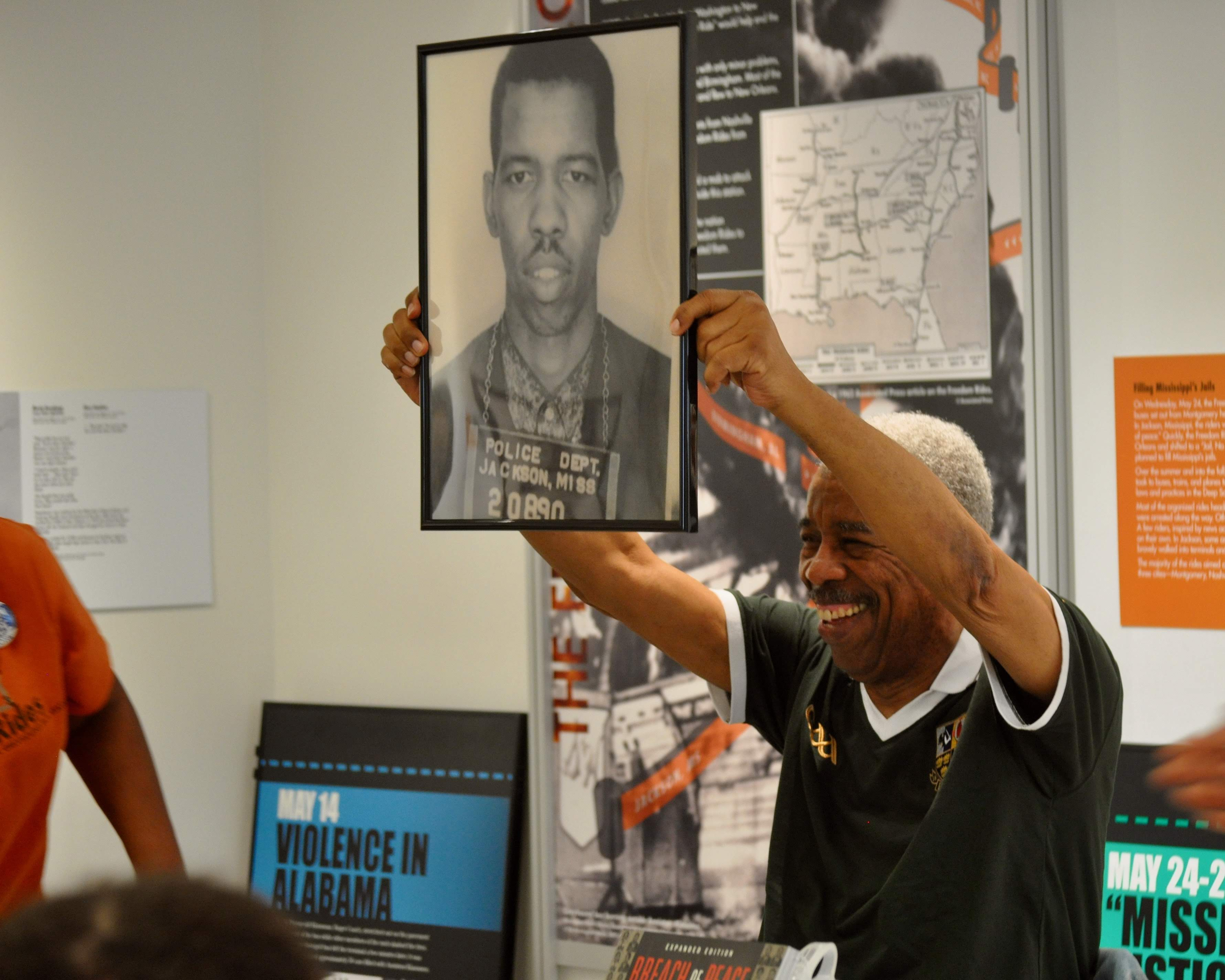 """Ernest """"Rip"""" Patton, Jr. holding a picture of himself during a visit to the Freedom Rides Museum in Montgomery, Alabama."""