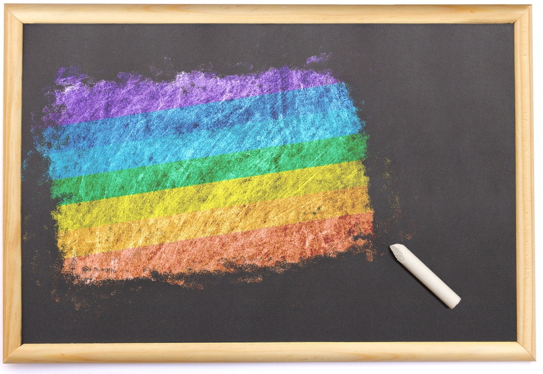 Pride flag drawn on a chalkboard
