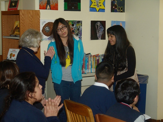 "Students discuss a passage of the book ""Soundless Roar"" with its author, Holocaust survivor Ava Kadishson Schieber."