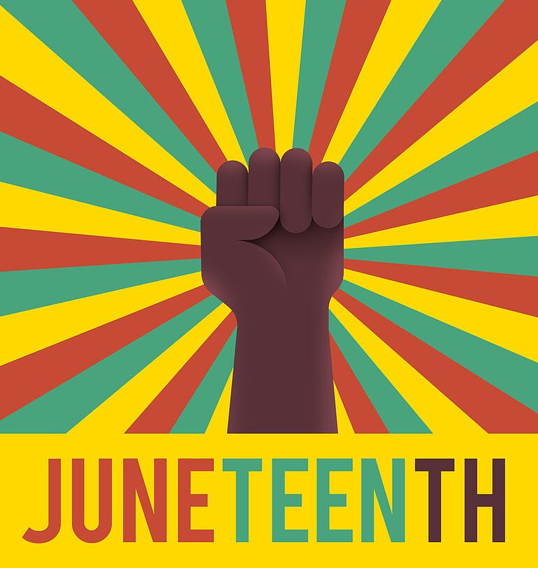 """Fist with the word """"Juneteenth"""""""